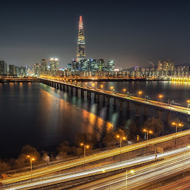 Lotte tower at night by Aaron Choi - City,  Street & Park  Night ( night light, han, famous, highway, road, gangnam, architecture, travel, capital, asian, city, songpa, lights, han river, subway, skyscraper, iconic, asia, city lights, railway bridge, district, korea, nigthscape, jamsil, architectural detail, tourism, jamsil railway bridge, urban landscape, korean, destination, urban, gangbyeon, landmark, lotte tower, traffic, night view, railway, seoul, night, viewpoint, view, bridge, freeway, lotte, river )