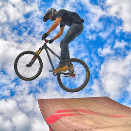 Crazy Stunts by Marco Bertamé - Sports & Fitness Other Sports ( clouds, wheel, stunt, ramp, jump, bicycle, flying, sky, vlue, red, cloudy, air, high )