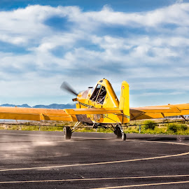 Yellow Plane Taxiing by Dave Lipchen - Transportation Airplanes ( clouds, taxiing, mountains, runway )