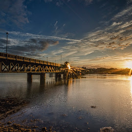 Walney Bridge Sunset by Graham Kidd - Buildings & Architecture Bridges & Suspended Structures ( clouds, water, sunset, bridge, dusk )