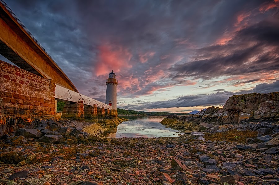 Evening Glow by Graham Kidd - Landscapes Cloud Formations ( water, clouds, sky, sunset, lighthouse )