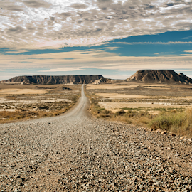Wild west road by Deyan Georgiev - Landscapes Travel ( mountain, america, street, sandstone, stone, rock, solitude, valley, travel, road, beauty, landscape, usa, navajo, tranquil, sky, butte, nature, american, arizona, southwest, dark, weather, monument, wild, sand, desert, peaceful, park, indian, horizon, canyon, tourism, scenic, tribal, mitten, history, wilderness, blue, utah, outdoors, summer, western, scenery, west )