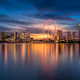 by Gordon Koh - City,  Street & Park  Night ( city, dusk, gbb, night, asia, modern ciity, long exposure, skyline, clouds, singapore flyer, modern, urban, sunset, ferries wheel, buildings, nightscape, marina bay sands, cityscape, garden by the bay, travel, blue hour, mbs )