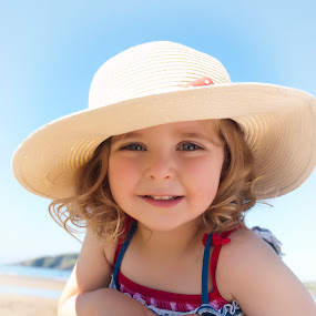 Fun in the Sun by Julie Wetherell - Babies & Children Toddlers ( child, girl, beautiful, sunhat, beach, pretty, eyes, hat )