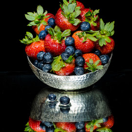 Berry Bowl Reflection by Jim Downey - Food & Drink Fruits & Vegetables ( strawberries, shiny bowl, blueberries, reflective, black )
