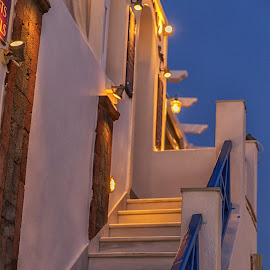 Dusk climbing by Dan Herman - Buildings & Architecture Other Exteriors ( lights, greece, oia, dusk, santorini )