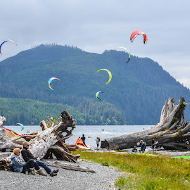 Kite surfing at Nitinat Lake on Vancouver Island BC Canada by Cory Bohnenkamp - Sports & Fitness Surfing ( mountains, kite surfing, surfing, nitinat, lake )