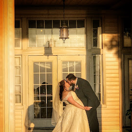 On the back porch by Patti Pappas - Wedding Bride & Groom ( kiss, sunset, wedding, porch )
