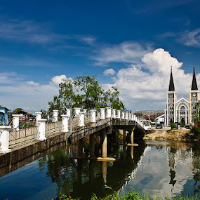 Bridge to Church and reflection by Vorravut Thanareukchai - Buildings & Architecture Places of Worship ( curve, reflection, blue sky, church, thailand, line, bridge, river )