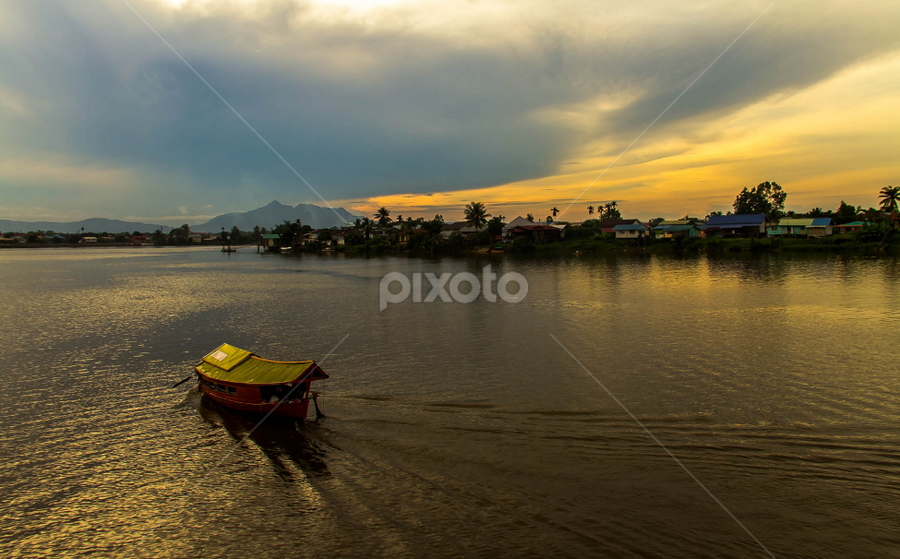 Balik Kampung. ( I'm coming home.) by Victor Sim - Transportation Boats ( clouds, sky, sunset, boats, holidays, travel, rivers )