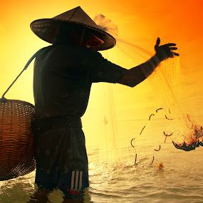 Checking the Net by Alit  Apriyana - People Portraits of Men