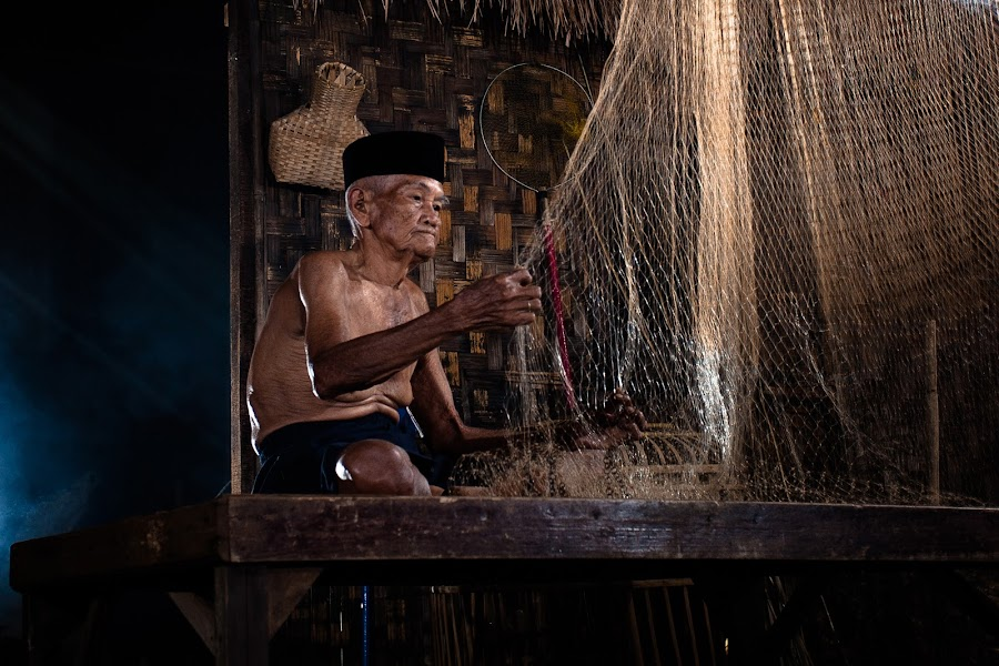 Old fisherman and his net by Aloysius Alphonso - People Portraits of Men