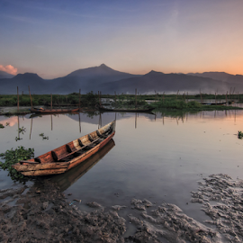 Enjoy the Mountains by Franciscus Satriya Wicaksana - Transportation Boats ( reflection, mountains, sky, waterscape, lake, boat, landscape )