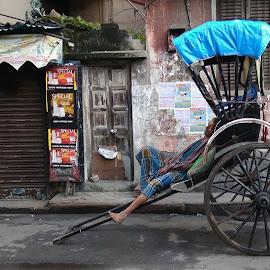 Time to rest by Sandip Das - City,  Street & Park  Street Scenes ( rest, street scene, rickshaw puller, street, rickshaw, street photography )