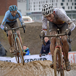 Fight In The Mud by Marco Bertamé - Sports & Fitness Cycling ( 2017, bicacle, fight, cyclo-cross, race, championships, luxembourg, muddy, two, mud, blue, determined, brown, duel, world, man, bieles )