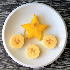 Banana slices and a star fruit by Svetlana Saenkova - Food & Drink Fruits & Vegetables ( banana, star fruit, carambola, star, white, slice,  )