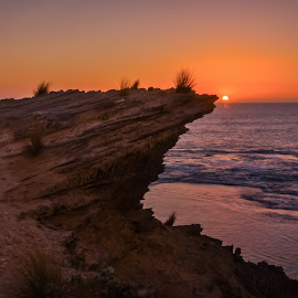 Cliffhanger Sunset. by Keith Walmsley - Landscapes Sunsets & Sunrises ( shore, rocky coast, waves, sunset, australia, cliff, victoria, landscape, coast )