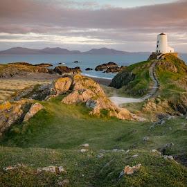 Llanddwyn Sunset by Kieran Metcalfe - Landscapes Beaches ( clouds, wales, anglesey, lighthouse, sea, beach, landscape, island, ynys llanddwyn, nature, sunset, llanddwyn, snowdonia, rocks, golden hour )