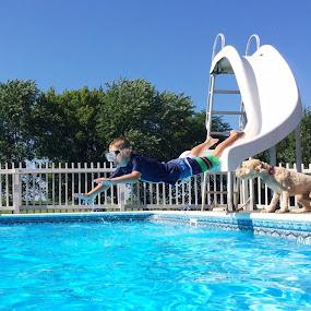 Summertime Fun by Amanda  Castleman  - Instagram & Mobile iPhone ( swimming, puppy, waterslide, recreation, boy, dog, summer, summertime,  )