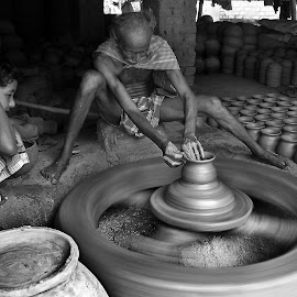 life on the wheel by Debarshi Sengupta - Professional People Business People ( little learner follow his future profession. )