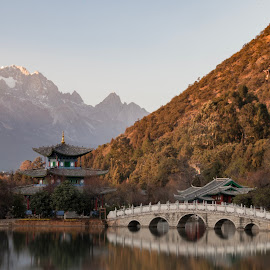 Peaceful by Marc-Olivier Jodoin - Landscapes Travel ( clouds, reflection, mountain, lake, architecture, travel, sun, ice mountain, sky, cold, ice, sunset, summer, bridge, china )