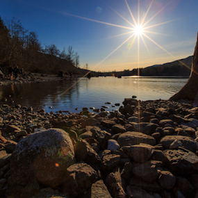 Rattlesnake Lake by Briand Sanderson - Landscapes Waterscapes ( water, starburst, waterscape, sunset, lake, flare, landscape, lens flare, diffraction,  )