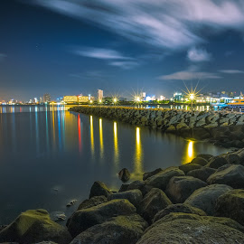 Bay Lights by Cynthia Pedrosa - Landscapes Waterscapes ( water, clouds, ocean, cityscape, boat, nightscape, city, sky, bay, stars, night, manila, rocks,  )