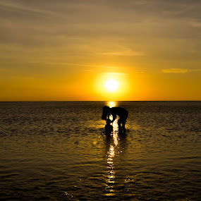mother's day by Christianto Mogolid - People Family ( mother, family, sunset, son, beach )
