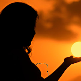 Holding Sun In Hand by Ahsan Changezi - Digital Art People ( girl, silhouette, sunset, people, photography )