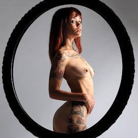Legless by DJ Cockburn - Digital Art People ( studio, torso, model, art nude, nude, auburn, circle, bicycle tyre, woman, redhead, surreal, lucerne, tattoo, standing )