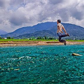 Levitation riverside by Satyam Joshi - Landscapes Waterscapes ( pwclevitation, canon, kathmandu, pokhara, mountain, pwcwaterscapes, pwcjump, nikon, pwcriver, sydney, nepal )