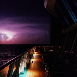 Lightning off the bow by Beverly Lee - Instagram & Mobile Android ( ship, bow, deck, boat, cruise )