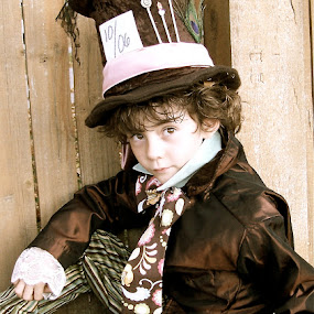 by Lori Lei Herr - Babies & Children Child Portraits ( jacket, expression, storybook, fairy tale, tie, green, children, brown hair, mad hatter, hat, halloween, child, story, brown eyes, fence, autumn, color, fall, costume, brown, boy )