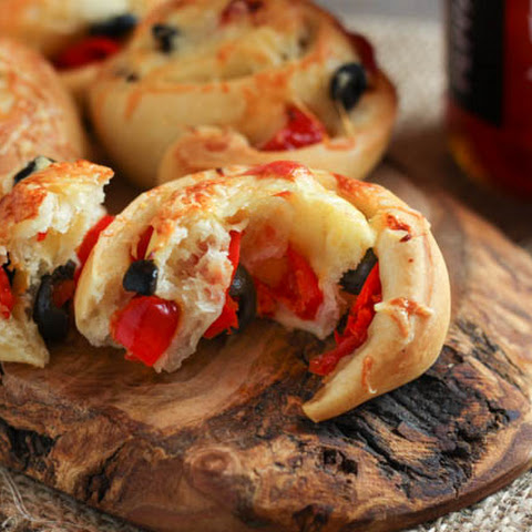 Black olive and Peppadew cheese rolls