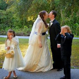 by Karen Hodges - Wedding Bride & Groom ( kiss, bride and groom, flower girl, wedding party )