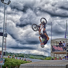 Salto On Wheels by Marco Bertamé - Sports & Fitness Other Sports ( clouds, wheel, dudelange, salto, grey, dow, bicycle, luxembourg )