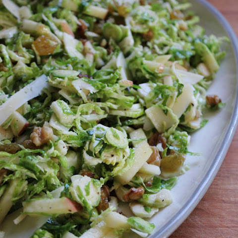 Brussel Sprout Salad with Apples, Golden Raisins, Walnuts & Parmesan