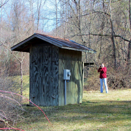 Small outside building by Terry Linton - Buildings & Architecture Other Exteriors ( building, wood, nature, woman, camera, photographers, taking a photo, photographing, photographers taking a photo, snapping a shot )