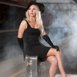 Waiting for a train by Chris O'Brien - People Portraits of Women ( location, fog, woman, blond, beauty, black dress, hat )