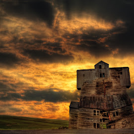 Bursting Clouds by Eric Demattos - Buildings & Architecture Decaying & Abandoned ( clouds, sunset, eric demattos, yellow, sunrise, storm, silo, abandoned )