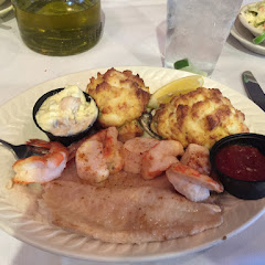 Gluten free seafood platter-fillet, crab cake, scallops, stuffed oyster, shrimp, and sides.  Plus warmed up bread.  Amazing!