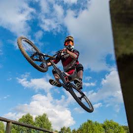 Bridge jump by Nick Moor - Sports & Fitness Cycling ( rider, blue sky, mtb, mountain bike, bridge, down hil )