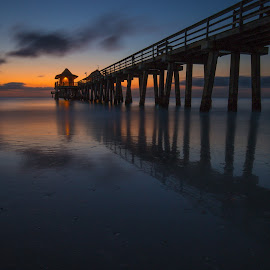 Naples Beach pier  by Emilio Portuondo - Buildings & Architecture Bridges & Suspended Structures ( water, clouds, reflection, naples, creative, colorful, twilight, beautiful, nice, seascape, beach, hues, amazing, great, sky, awesome, florida, naples pier, pier, long exposure, gulf of mexico, interesting, evening, wonderful )