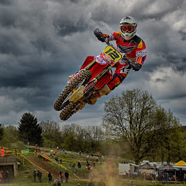 Red Twelve by Marco Bertamé - Sports & Fitness Motorsports ( clouds, speed, green, number, yellow, race, noise, jump, 12, flying, red, motocross, dust, cloudy, grey )