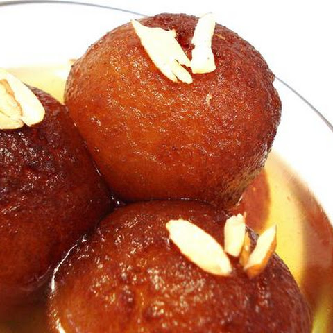 Golden Fried Milk Balls In Flavored Sugar Syrup