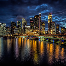 Twilight Glory by Gordon Koh - City,  Street & Park  Skylines ( shenton way, skyline, reflection, waterscape, cityscape, singapore, city, modern, lights, by the river, blue sky, skyscraper, grand, jubilee, long exposure, clouds, water, shenton, blue hour, beautiful, twilight, cloudscape, nightscape, urban, blue, bay, vista, night, bridge, jubilee bridge, waterfront, river )