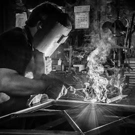 The Blacksmith by Loris Calzolari - Black & White Portraits & People ( blacksmith, b&w, black and white, job, street photography )