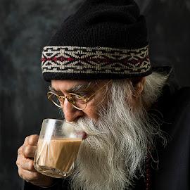 Enjoying his tea by Rakesh Syal - People Portraits of Men