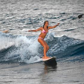 _DSC0260 girl surfing nuwiliwili harbor.jpg