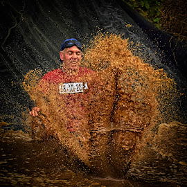 Strong, Splash, Fun ! by Marco Bertamé - Sports & Fitness Other Sports ( water, splatter, splash, differdange, 2015, cap, 18, eyes closed, number, soup, waterdrops, luxembourg, 10, mud, sliding, red, strong, blue, dirty, drops, brown, strongmanrun, man )